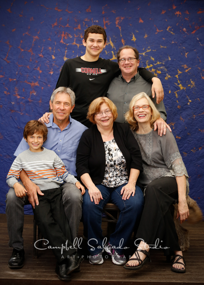 Portrait of extended family on Frida background by family photographers at Campbell Salgado Studio, Portland, Oregon.