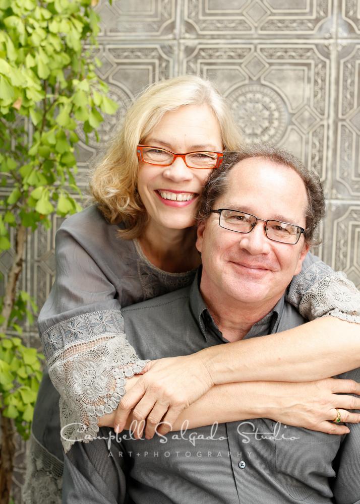 Portrait of coupleon gray tilesbackgroundby family photographers at Campbell Salgado Studio, Portland, Oregon.