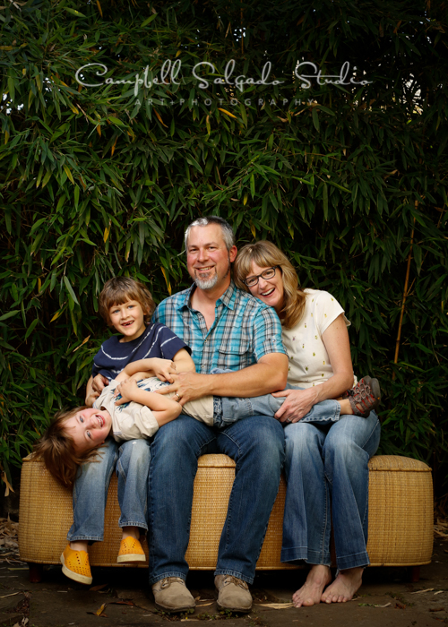 Portrait of family on bamboo background by family photographers at Campbell Salgado Studio, Portland, Oregon.