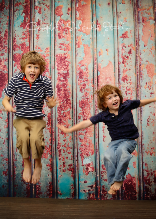 Portrait of boys on Italian rust background by children's photographers at Campbell Salgado Studio, Portland, Oregon.