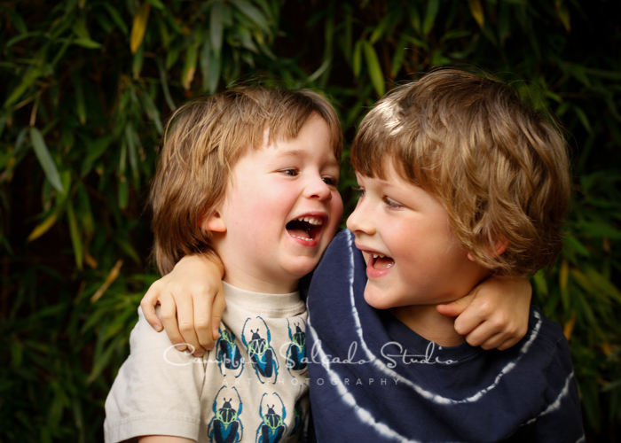 Portrait of brothers on bamboo background by child photographers at Campbell Salgado Studio, Portland, Oregon.