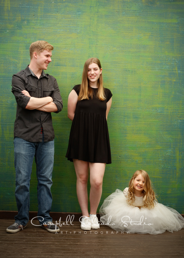 Portrait of siblings on blue green weave background by family photographers at Campbell Salgado Studio, Portland, Oregon.