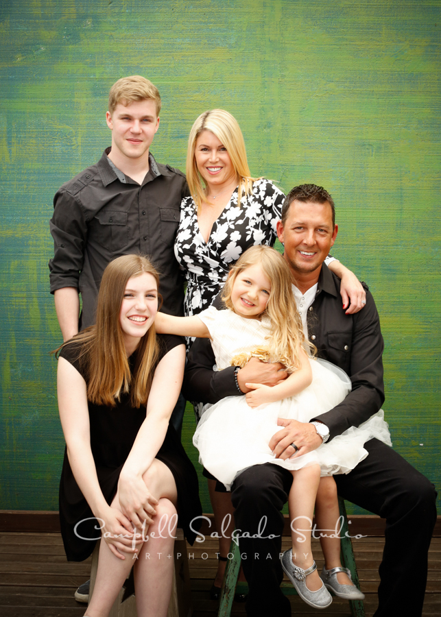 Portrait of family on blue green weave background by family photographers at Campbell Salgado Studio, Portland, Oregon.