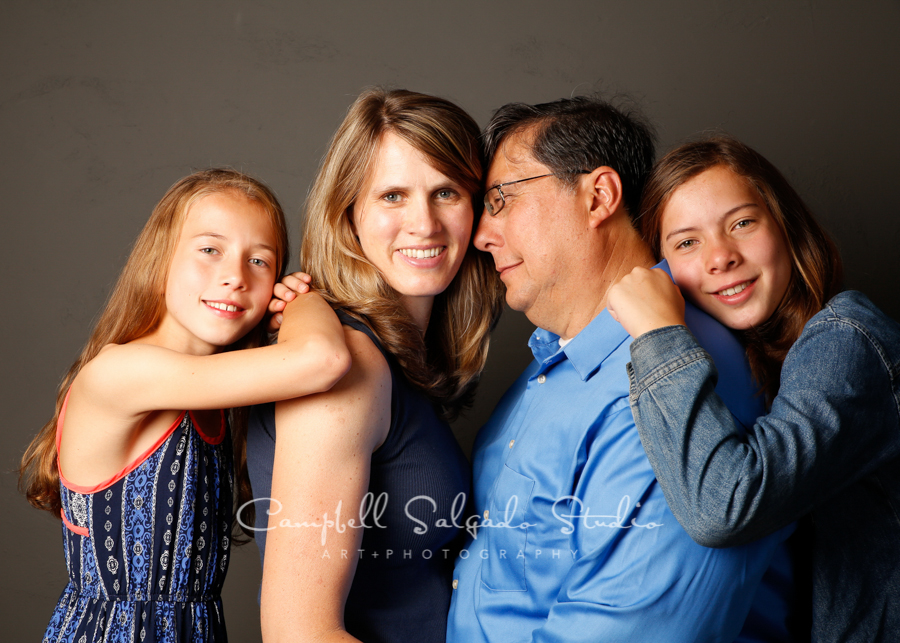 Portrait of family on grey background by family photographers at Campbell Salgado Studio, Portland, Oregon.