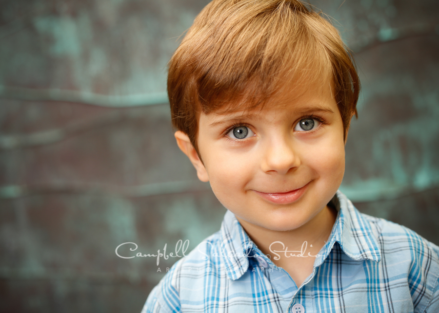 Portrait of boy on copper wave background by family photographers at Campbell Salgado Studio, Portland, Oregon.