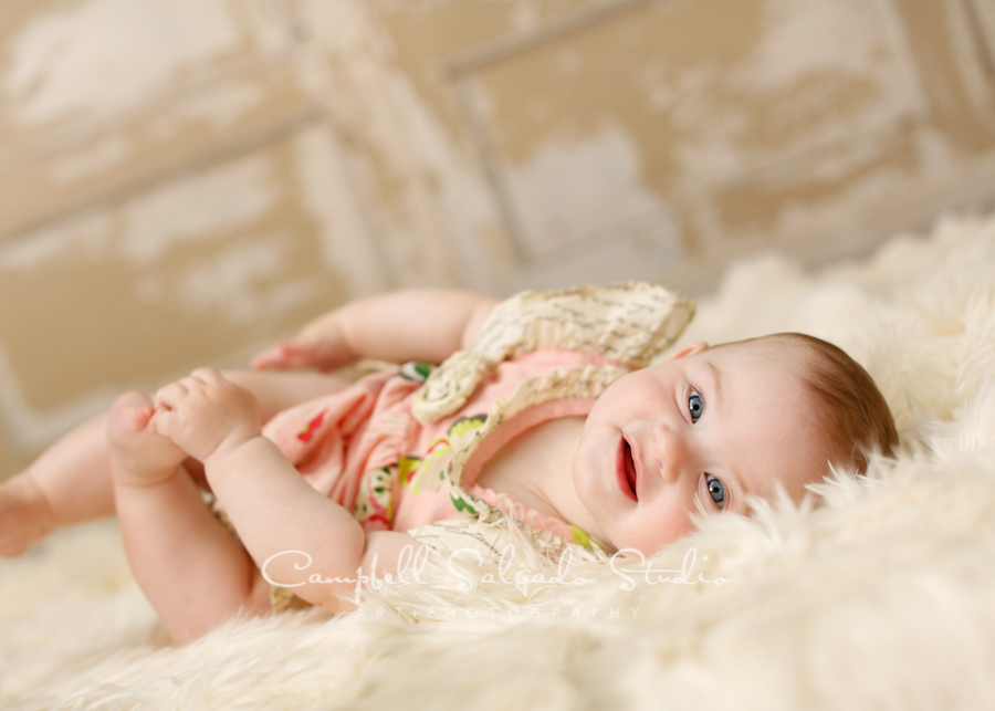 Portrait of baby on antique ivory doors background by childrens photographers at Campbell Salgado Studio, Portland, Oregon.