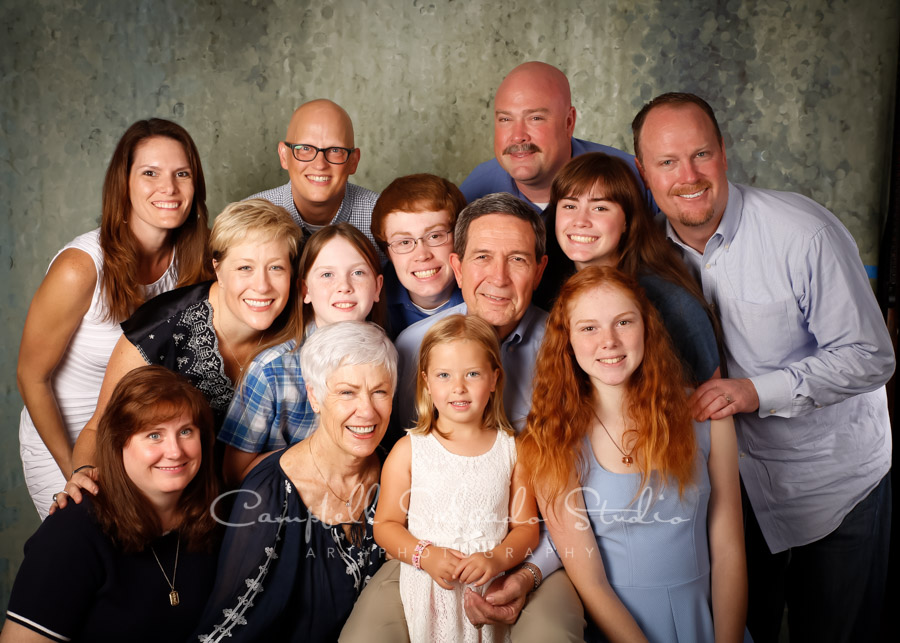 Portrait of multi-generational family on rain dance background by family photographers at Campbell Salgado Studio.