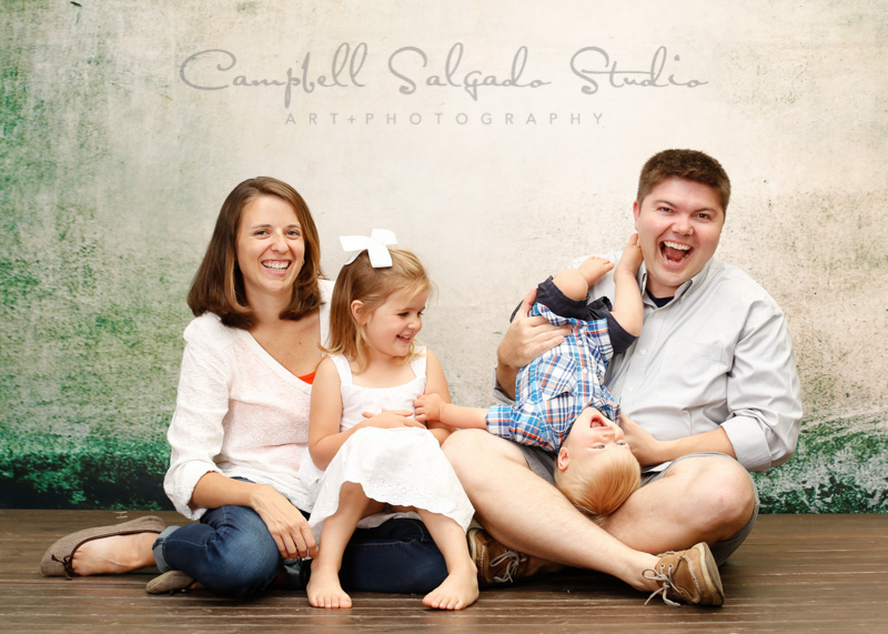 Portrait of a happy family by family photographers at Campbell Salgado Studio, Portland, Oregon