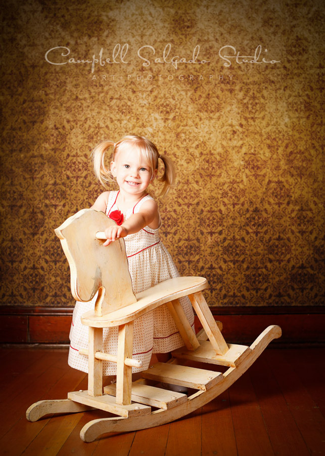 Portrait of girl on amber light background by child photographers at Campbell Salgado Studio in Portland, Oregon.