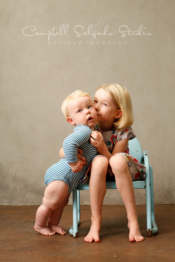 Portrait of siblings on modern grey background by childrens photographers at Campbell Salgado Studio in Portland, Oregon.