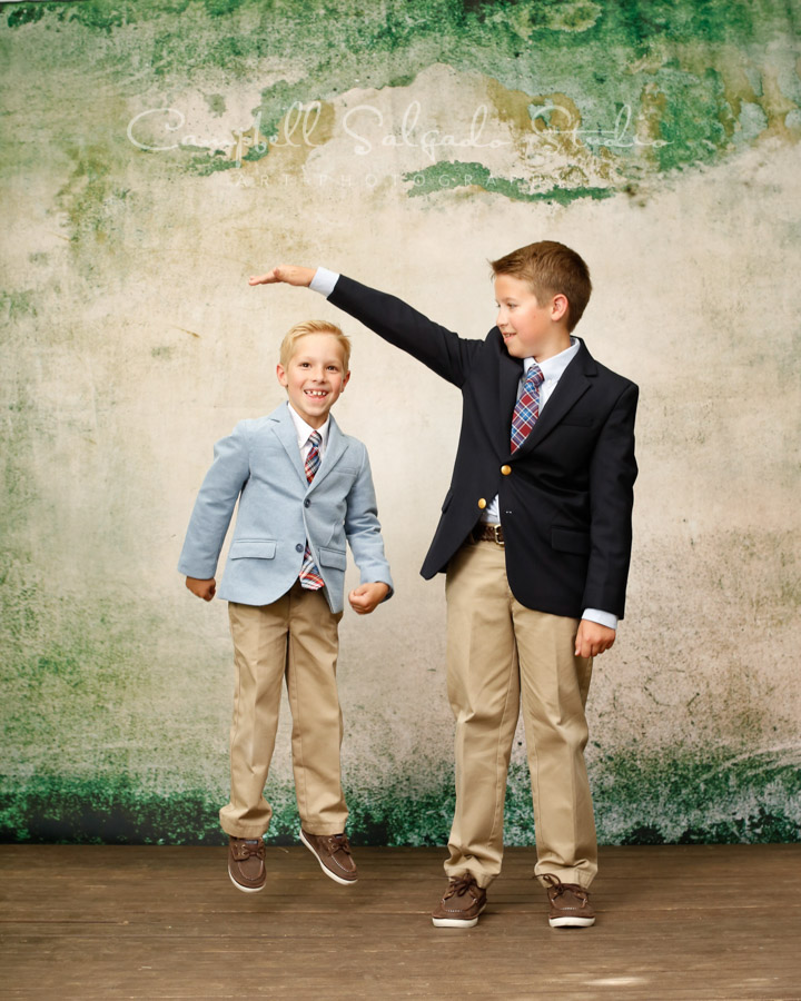 Portrait of brothers on abandoned concrete background by child photographers at Campbell Salgado Studio in Portland, Oregon.