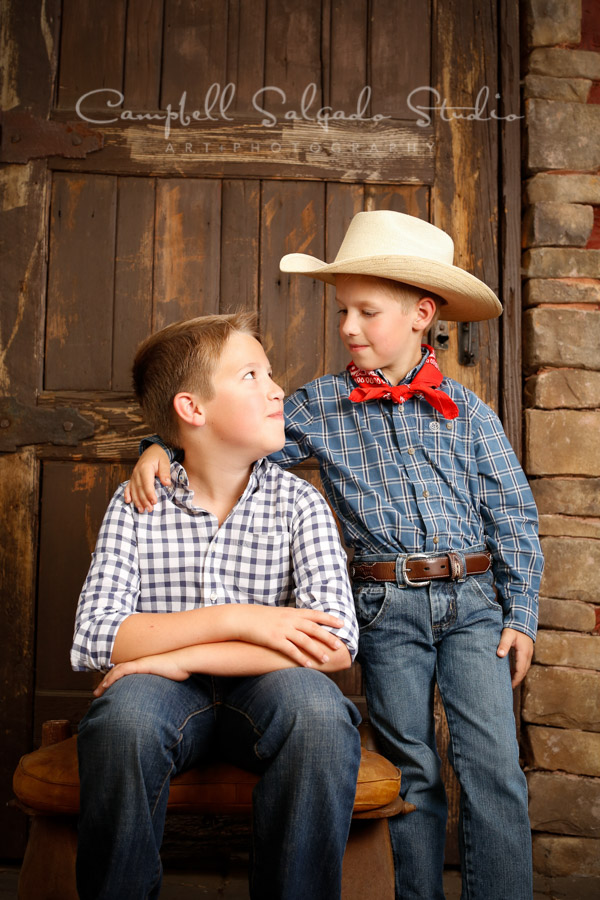 Portrait of brothers on rustic door background by child photographers at Campbell Salgado Studio in Portland, Oregon.