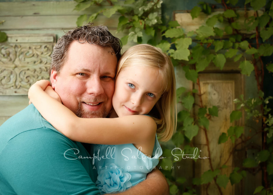 Portrait of father and daughter on vintage green doors background by family photographers at Campbell Salgado Studio in Portland, Oregon.