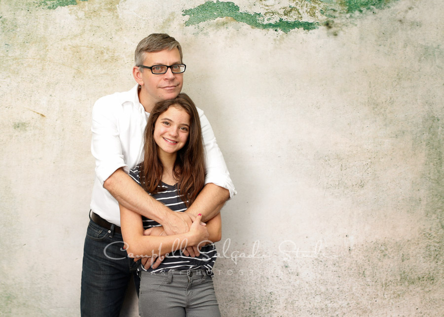 Portrait of father and daughter on abandoned concrete background by family photographers at Campbell Salgado Studio in Portland, Oregon.