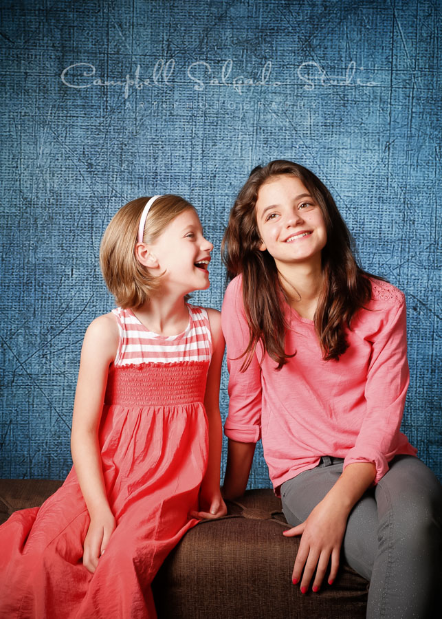 Portrait of sisters on denim background by family photographers at Campbell Salgado Studio in Portland, Oregon.