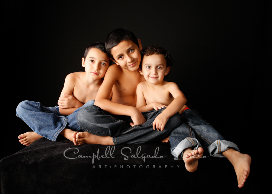 Portrait of kids on black background by children's photographers at Campbell Salgado Studio in Portland, Oregon.