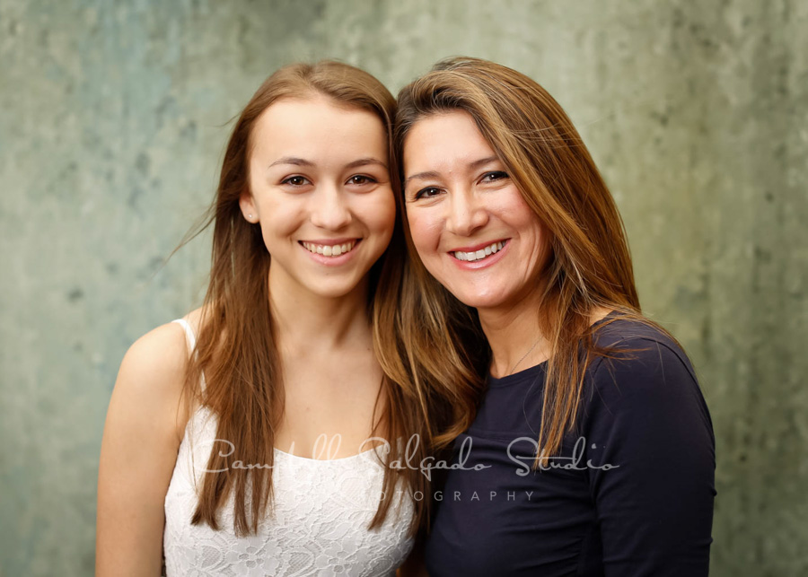 Portrait of mother and daughter on rain dance background by family photographers at Campbell Salgado Studio in Portland, Oregon.