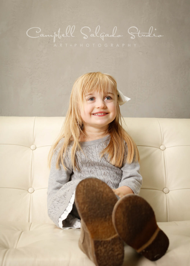 Portrait of child on modern grey background by child photographers at Campbell Salgado Studio in Portland, Oregon.