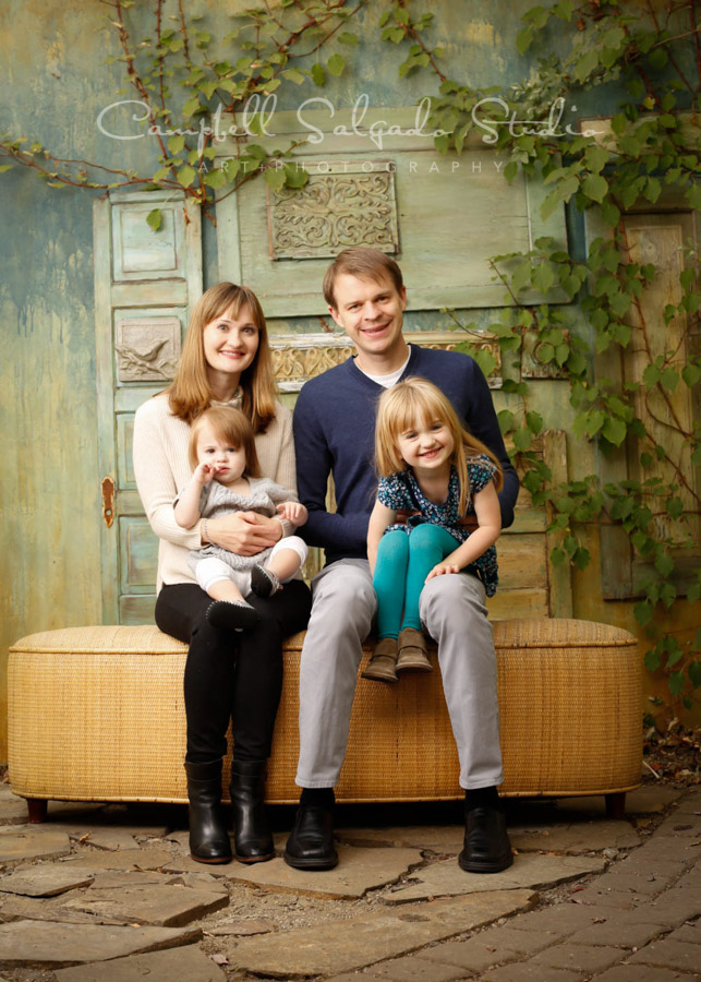 Portrait of family on vintage doors background by family photographers at Campbell Salgado Studio in Portland, Oregon.