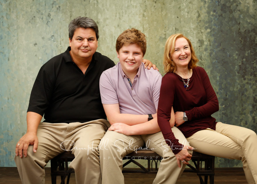 Portrait of family on rain dnace background by family photographers at Campbell Salgado Studio in Portland, Oregon.