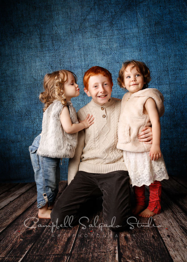 Portrait of children on denim background by child photographers at Campbell Salgado Studio in Portland, Oregon.