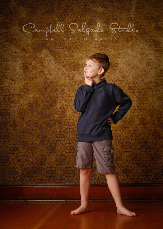 Portrait of child on amber light background by child photographers at Campbell Salgado Studio in Portland, Oregon.