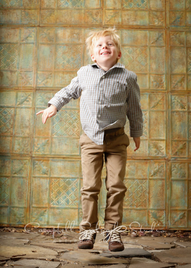 Portrait of child on vintage colored tin background by children's photographers at Campbell Salgado Studio in Portland, Oregon.