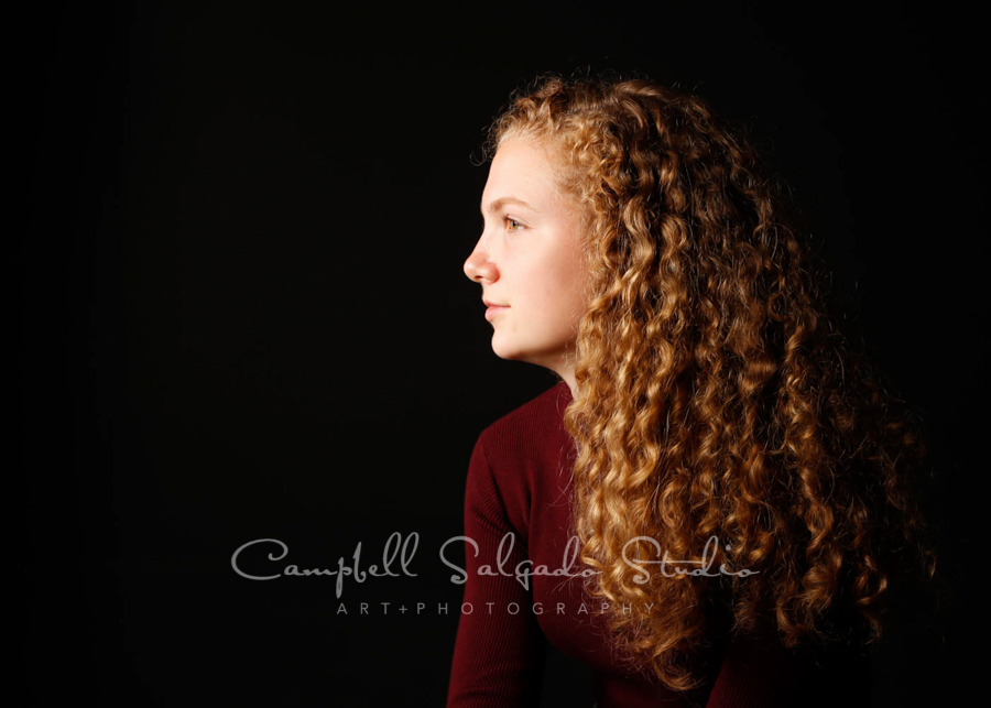 Portrait of teen on black background by teen photographers at Campbell Salgado Studio in Portland, Oregon.