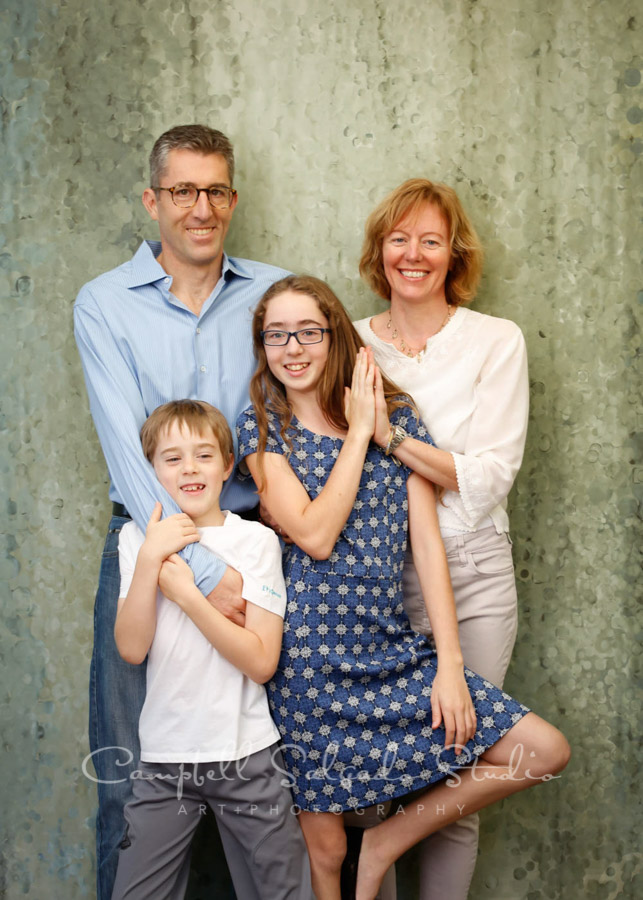 Portrait of family on rain dance background by family photographers at Campbell Salgado Studio in Portland, Oregon.