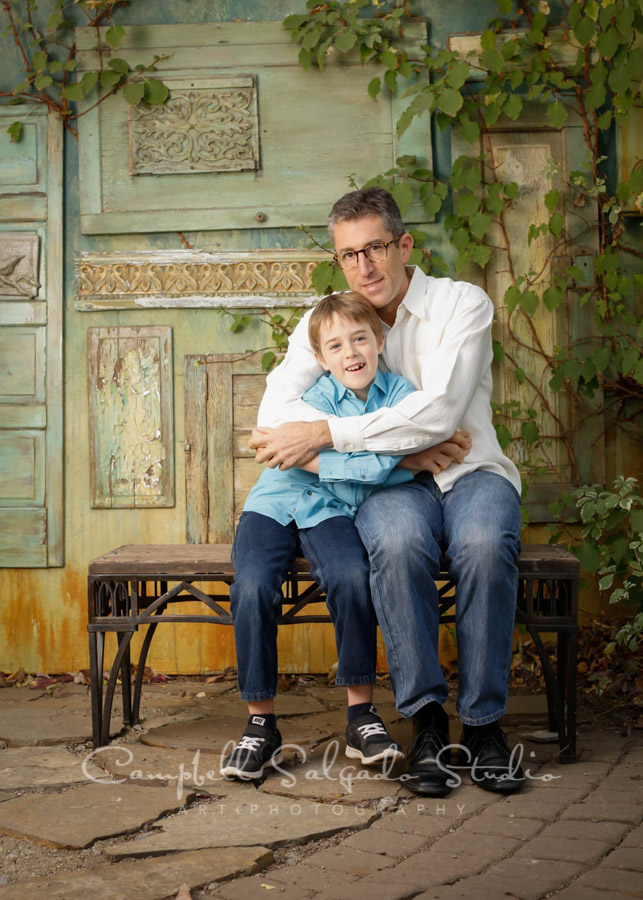 Portrait of father and son on vintage green doors background by family photographers at Campbell Salgado Studio in Portland, Oregon.