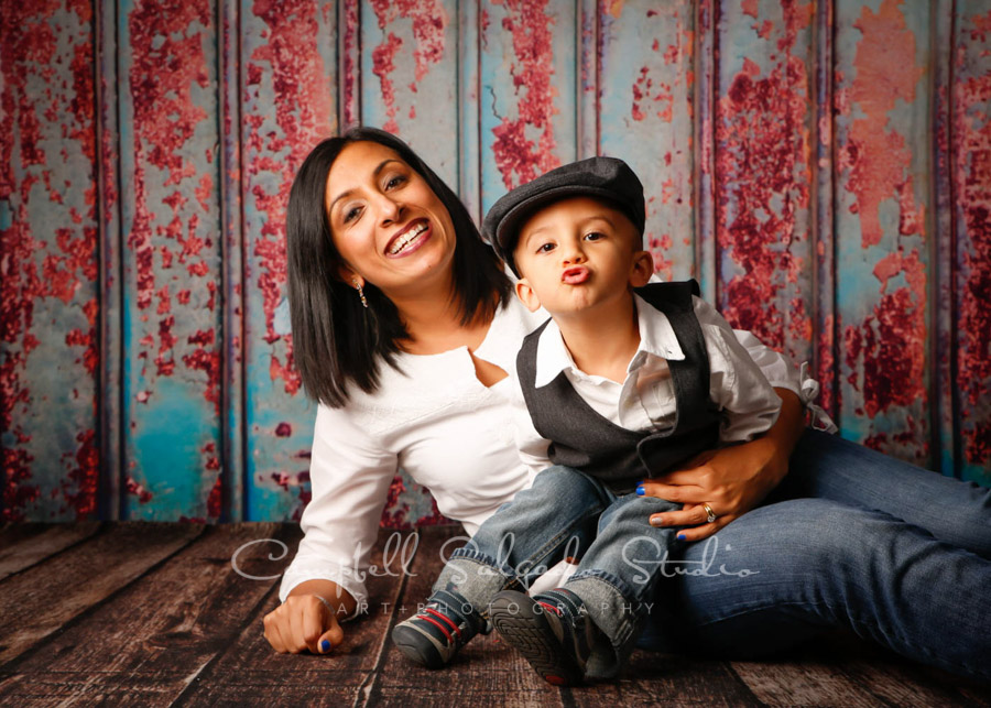 Portrait of mother and son on Italian rust background by family photographers at Campbell Salgado Studio in Portland, Oregon.
