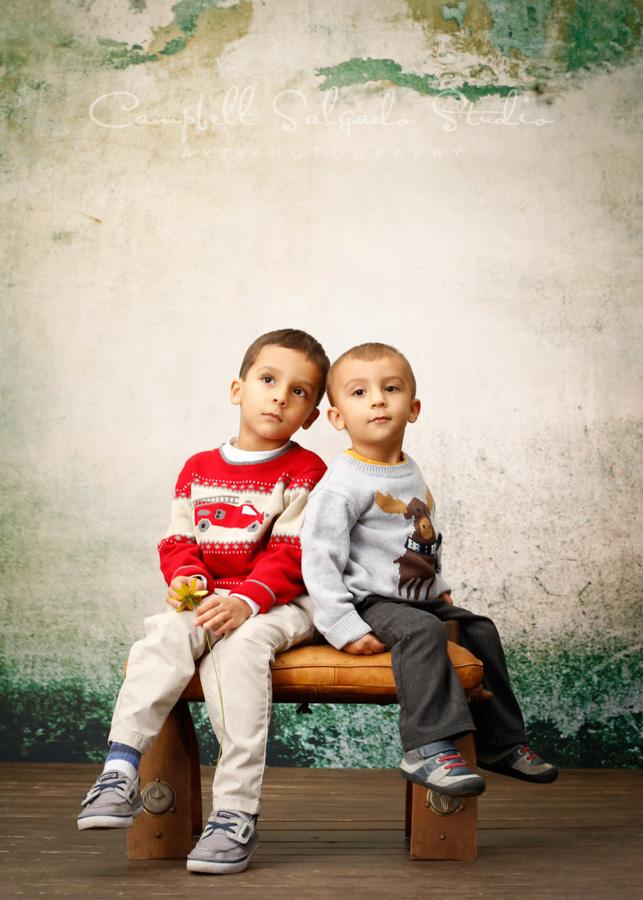 Portrait of children on abandoned concrete background by child photographers at Campbell Salgado Studio in Portland, Oregon.