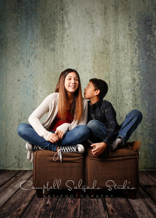 Portrait of children on rain dance background by family photographers at Campbell Salgado Studio in Portland, Oregon.