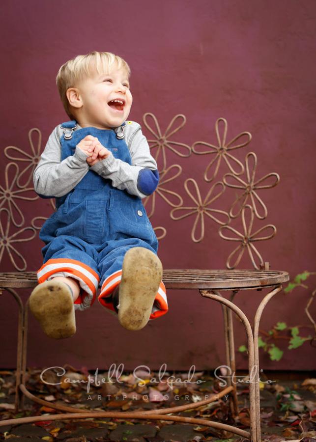 Portrait of boy on plum background by children's photographers at Campbell Salgado Studio in Portland, Oregon.