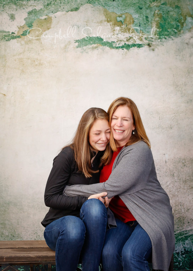 Portrait of mother and daughter on abandoned concrete background by family photographers at Campbell Salgado Studio in Portland, Oregon.