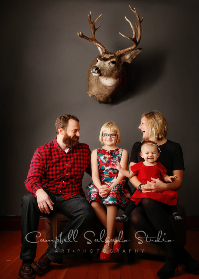 Portrait of family on gray  background  by  family  photographers at Campbell Salgado Studio in  Portland , Oregon.