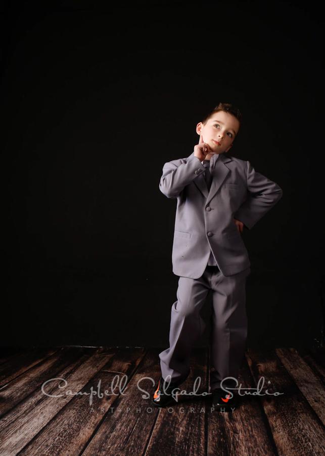 Portrait of child on black background by child photographers at Campbell Salgado Studio in Portland, Oregon.
