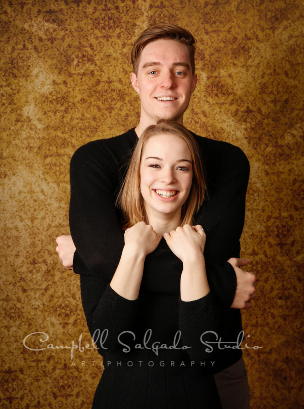 Portrait of teens on amber light background by family portrait photographers at Campbell Salgado Studio in Portland, Oregon.