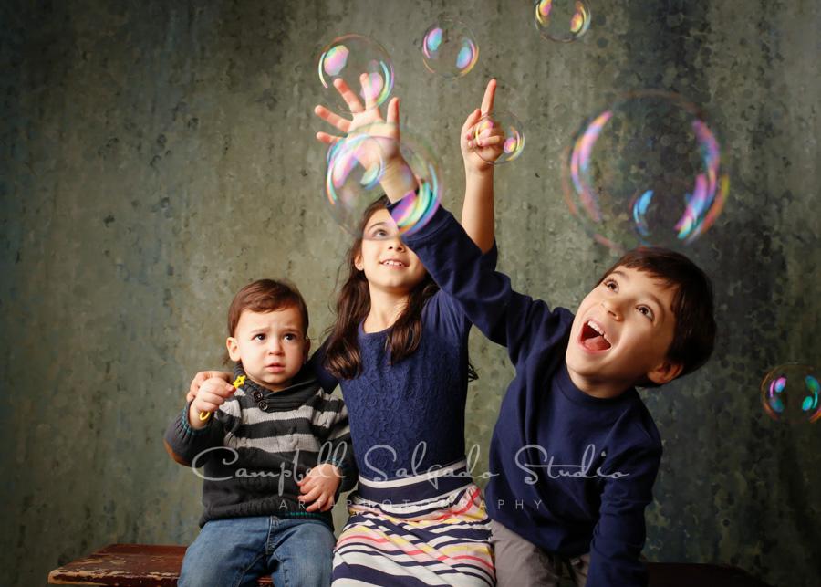 Portrait of kids on rain dance background by child photographers at Campbell Salgado Studio in Portland, Oregon.