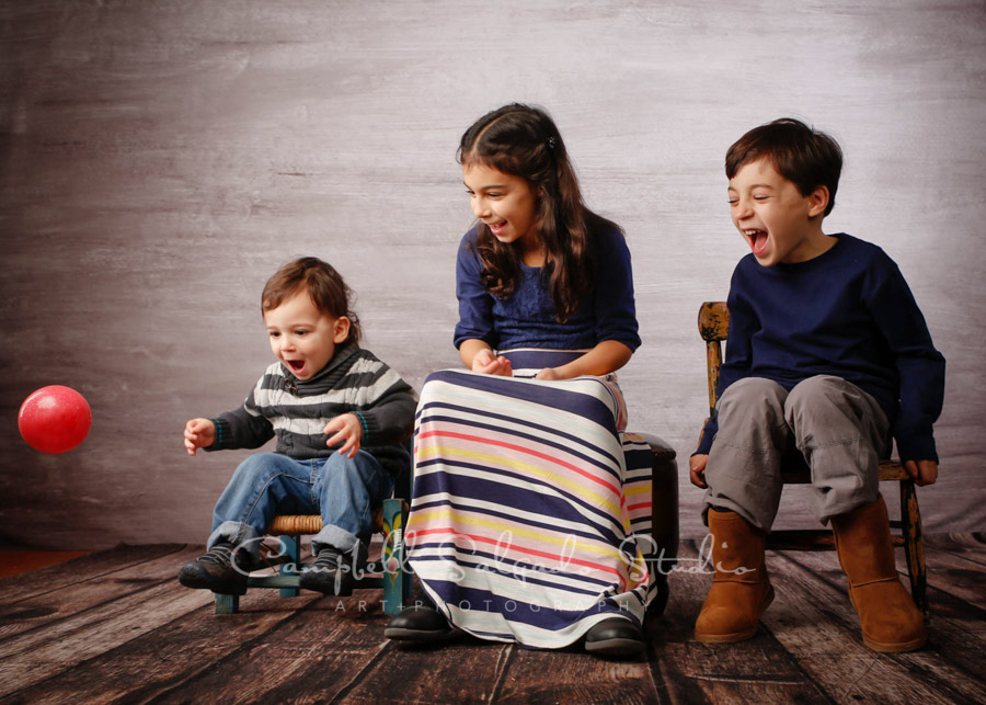 Portrait of kids on graphite background by child photographers at Campbell Salgado Studio in Portland, Oregon.