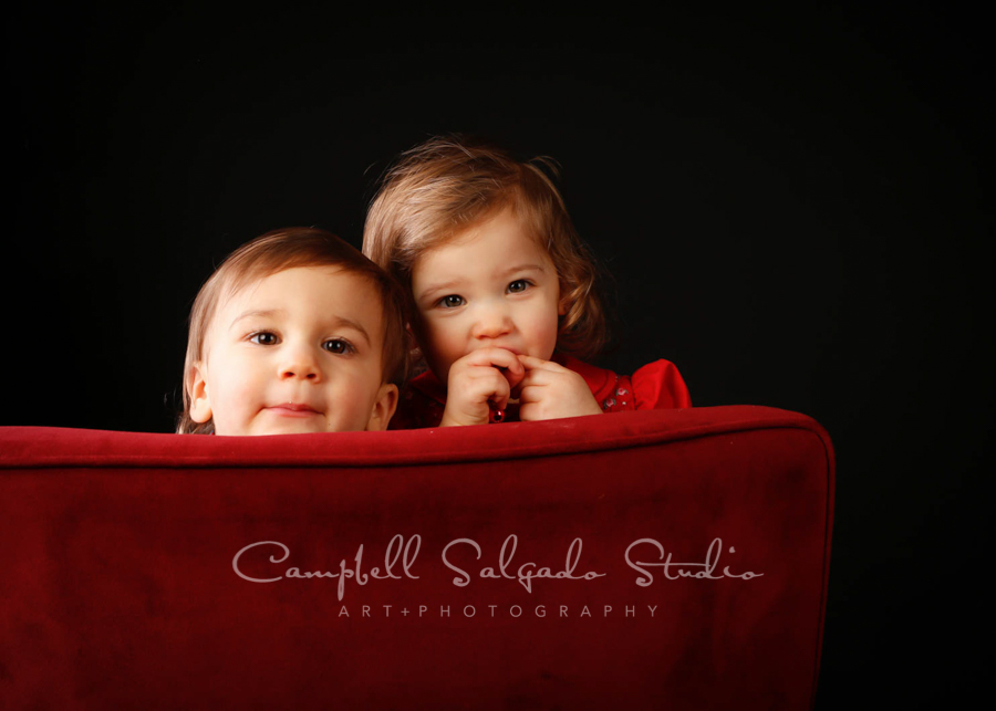 Portrait of twins on black background by child photographers at Campbell Salgado Studio in Portland, Oregon.