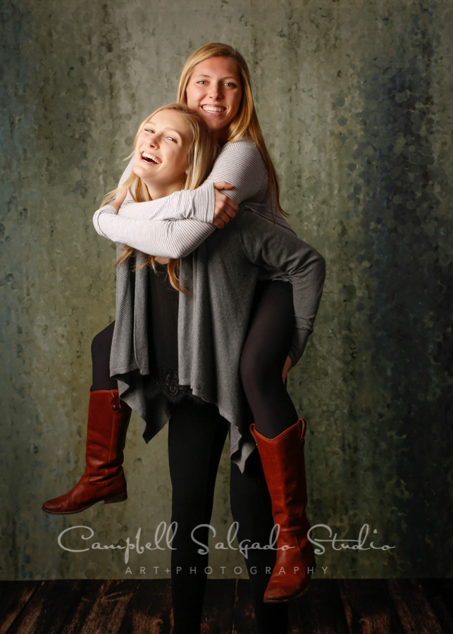 Portrait of sisters on rain dance background by family photographers at Campbell Salgado Studio in Portland, Oregon.