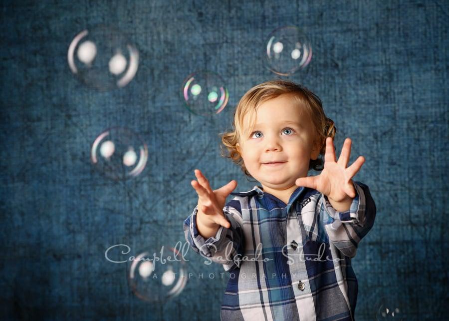 Portrait of child on denim background by child photographers at Campbell Salgado Studio in Portland, Oregon.