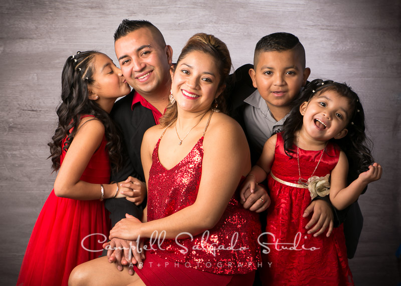 Family photography of a smiling family of 5 at Campbell Salgado Studio in Portland, Oregon.