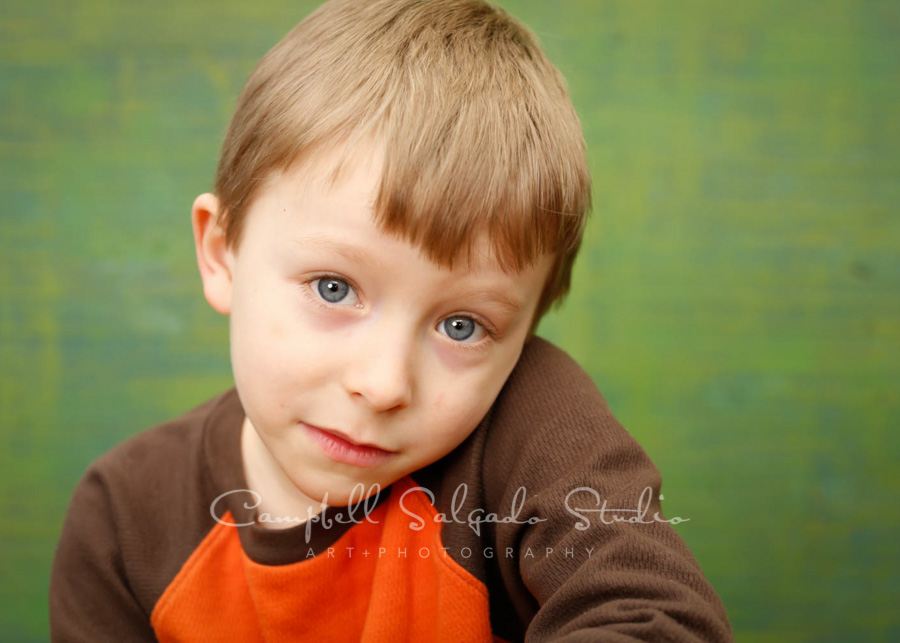 Portrait of boy on blue green weave background by children's photographers at Campbell Salgado Studio in Portland, Oregon.