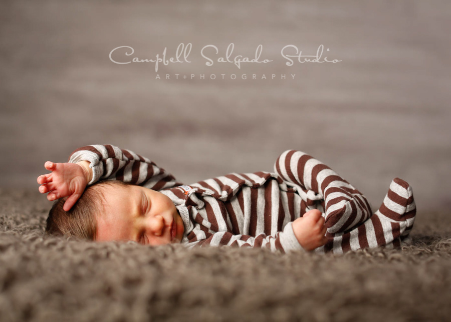 Portrait of infant on graphite background by infant photographers at Campbell Salgado Studio in Portland, Oregon.
