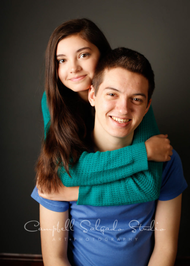Portrait of teens on grey background by teen photographers at Campbell Salgado Studio in Portland, Oregon.
