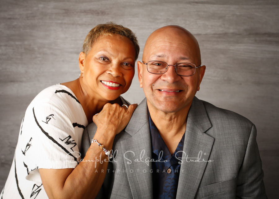 Portrait of couple on graphite background by couples photographers at Campbell Salgado Studio in Portland, Oregon.