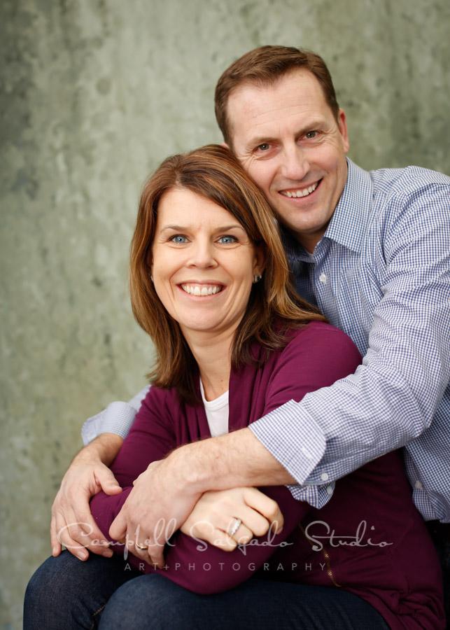 Portrait of couple on rain dance background by family photographers at Campbell Salgado Studio in Portland, Oregon.