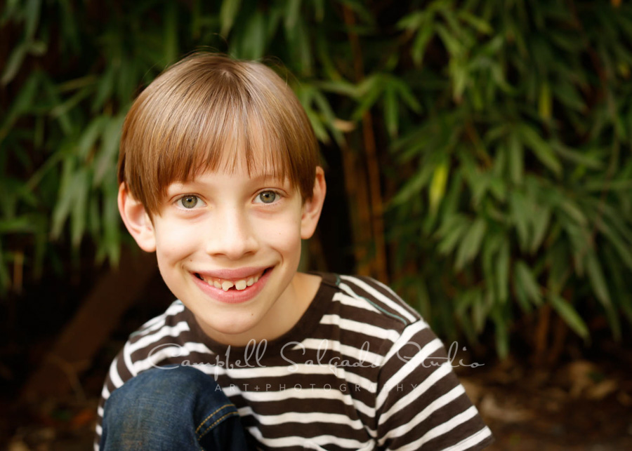 Portrait of boy on bamboo background by child photographers at Campbell Salgado Studio in Portland, Oregon.